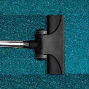 Teppich und Staubsauger
